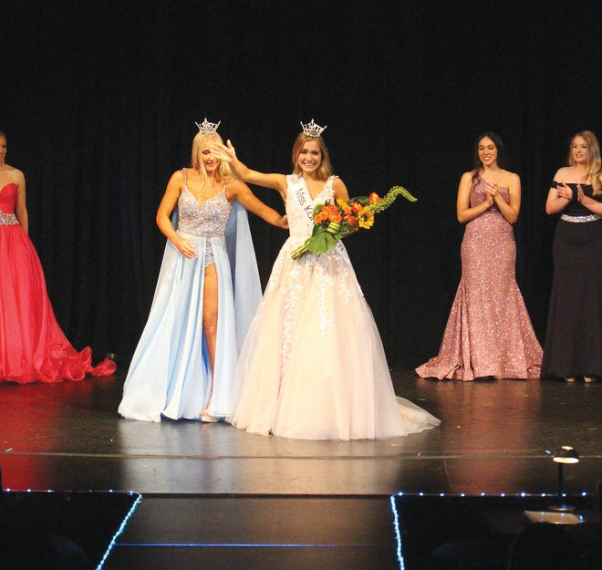 Miss Kansas Outstanding Teen 2019 and 2020 Tori Pedruzzi assists newly crowned Miss Johnson County Gracie Hendrickson into the limelight on Saturday in Pratt.