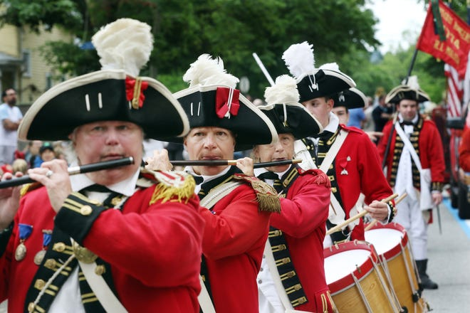 Members of the Pawtuxet Rangers perform in Saturday's Gaspee Days Parade in Warwick, a prelude to the ceremonial Burning of the Gaspee, commemorating the Colonial act of rebellion that helped spark the American Revolution.