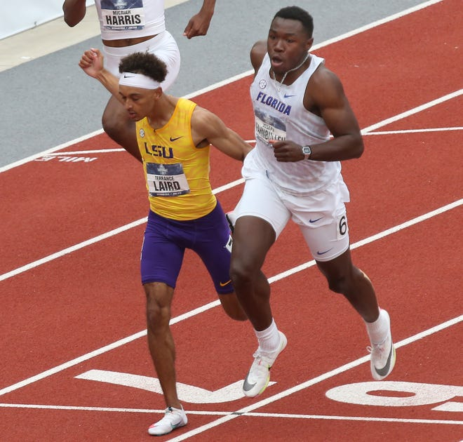 Florida's Joseph Fahnbulleh, right, edges LSU's Terrance Laire at the finish to win the men's 200 meters at the  NCAA Outdoor Track and Field Championship.