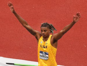 JuVaughn Harrison acknowledges the crowd after winning the men's high jump at the NCAA Outdoor Track and Field Championships at Hayward Field.