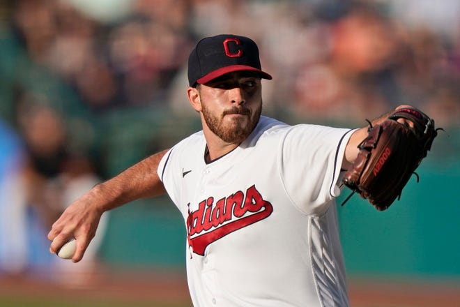 Cleveland starting pitcher Aaron Civale delivers in the first inning of a win over Seattle, Friday, June 11, 2021, in Cleveland. (AP Photo/Tony Dejak)