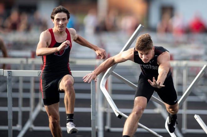 Forreston's Bennett Soltow, left, runs past Byron's Leo Adami as he stumbles over the last hurdle in the 110-meter high hurdles at Winnebago High School on Friday, June 11, 2021, in Winnebago.