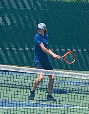 Rockford Christian junior Finley Buelte, shown playing earlier this year, finished fifth in the Class 1A state boys tennis tournament in singles.