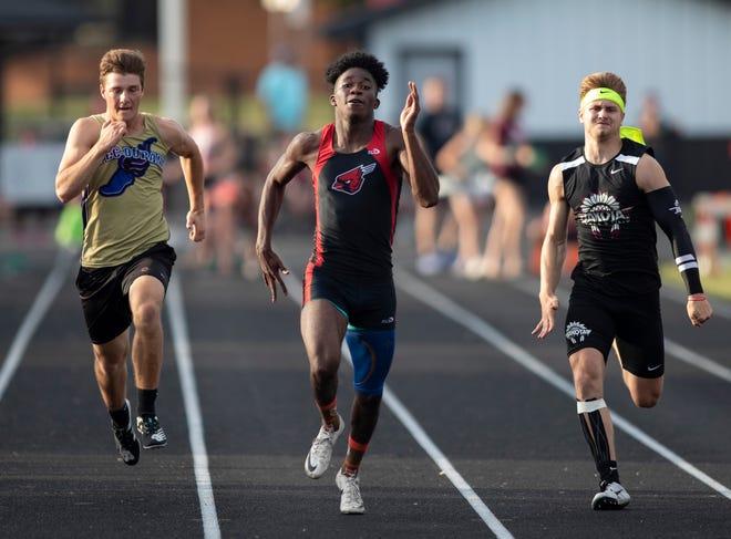 Forreston-Polo's Jordan Neuschwander places first in the 100-meter dash at Winnebago High School on Friday, June 11, 2021, in Winnebago.