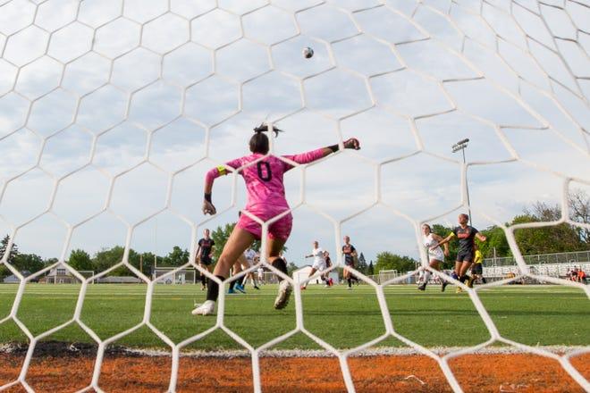 Freeport's goalie Naomi Jackson saves the ball against Burlington Central in the first half of their game at Freeport High School Friday, June 11, 2021, in Freeport.