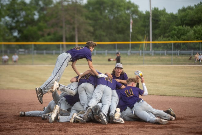 Hononegah players dogpile each other after Ryan Anderson's walk-off single in the ninth inning to beat Huntley 3-2 and win the school's first-ever baseball sectional title at Hononegah High School on Friday, June 11, 2021 in Rockton.