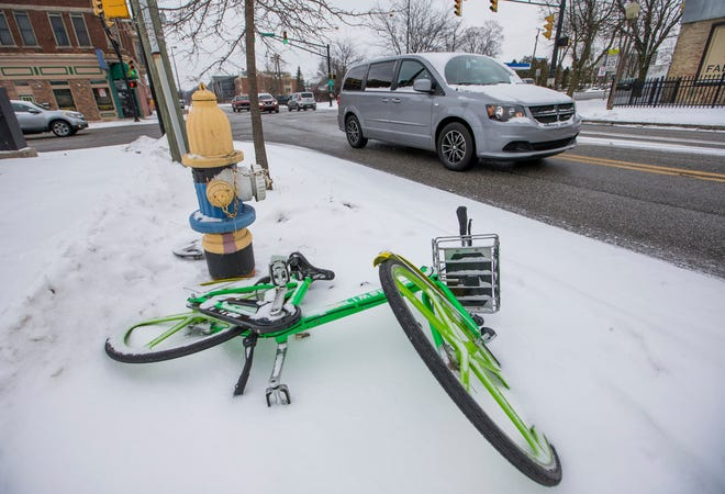 A Lime bike left along Niles Avenue in December 2017 in South Bend. The city wants the next shared mobility vendor to do a better job of collecting devices and stationing them in heavy-use areas. Tribune Photo/ROBERT FRANKLIN