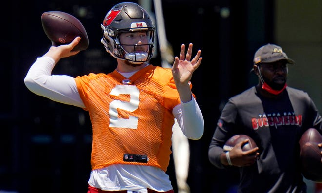 Tampa Bay Buccaneers quarterback Kyle Trask throws a pass during a Buccaneers NFL football rookie minicamp Friday, May 14, 2021, in Tampa, Fla. Trask, from Florida, was drafted by the Buccaneers in the second round. (AP Photo/Chris O'Meara)