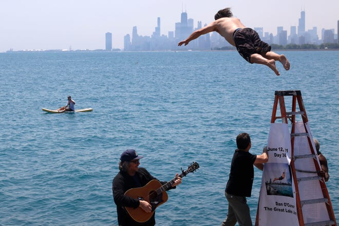 """Dan O'Conor, the """"Great Lake Jumper,"""" makes his 365th leap into Lake Michigan on Saturday at Chicago's Montrose Point."""