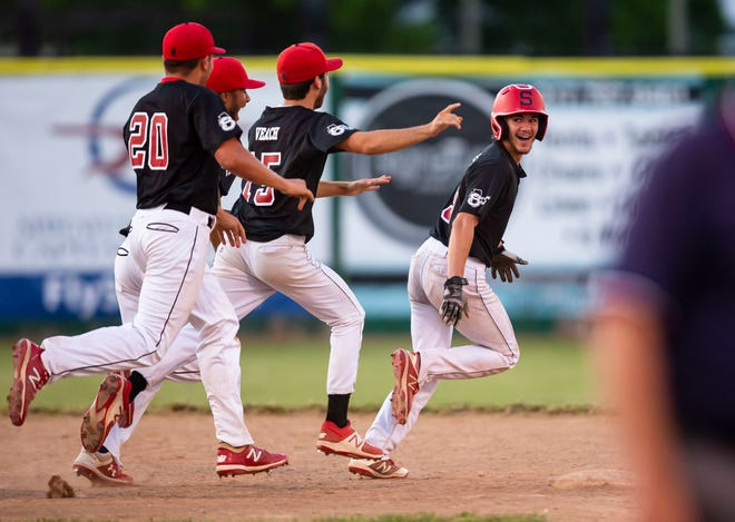 Springfield's Adam Passmore (5) is swarmed by his teammates after his winning hit propelled the Senators past Glenwood 13-12 in the ninth inning during Friday's Class 3A Sectional Championship at Robin Roberts Stadium in Springfield. [Justin L. Fowler/The State Journal-Register]