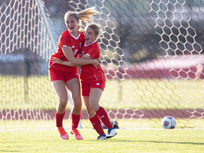 Glenwood's Savannah Bell (5) celebrates her goal with teammate Mia O'Neill (8) against Rochester in the second half during the Class 2A Sectional Championship on Friday at Glenwood High School in Chatham. [Justin L. Fowler/The State Journal-Register]