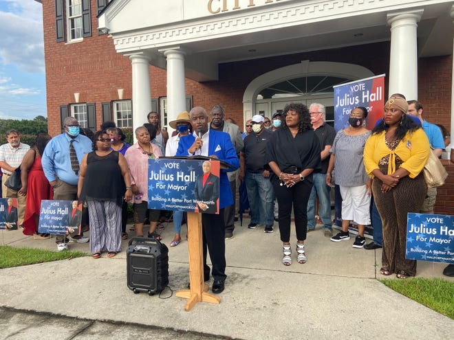 Julius Hall announces his intent to run for mayor of Port Wentworth in front of the city hall building.