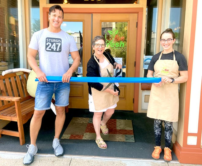 """DDA event coordinator Ryan Conrod, Betsy Rambadt and Cecilia Sprowls are among the many preparing for a downtown Sturgis """"Grand Reopening"""" event. Rambadt is co-owner of Olive Fresh along with Kim Haller, Sprowls is a sales associate."""