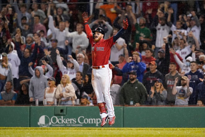 Boston Red Sox's Alex Verdugo celebrates after hitting a walkoff-single in the ninth inning against the Toronto Blue Jays at Fenway Park.