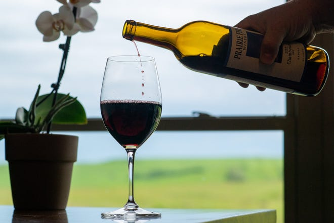 Enjoying a glass of wine at Prairie Fire Winery, 20250 Hudson Ranch Road in Paxico, gets you away from the city to enjoy views of the Flint Hills.