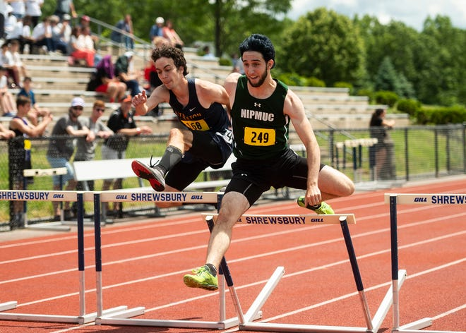 Nipmuc's Ben Skiba (right) and Littleton's Cam McLeod compete in the 400 hurdles during the Central Mass. boys' track class championships at Shrewsbury High on  June 12, 2021.