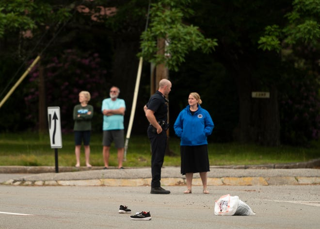 Worcester police talk to people at the scene where a city boy was injured after being struck by a landscaping van Friday afternoon on Pleasant Street.
