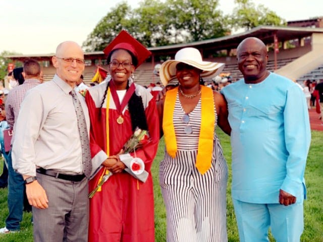 Fitchburg High principal Jeremy Roche with Verda Tetteh and her parents Rosemary Annan and Leslie Barnor.