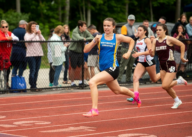 Whitinsville Christian's Kira Simoncini stays ahead of competitors during the 100-meter dash at Saturday's district class meet.