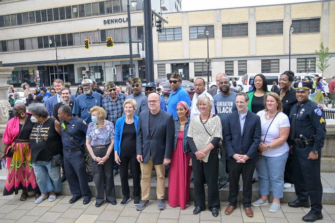 Elected officials, including Sen. Elizabeth Warren and Rep. Jim McGovern, and members of the Black Heritage Juneteenth Festival committee at the Juneteenth flag raising ceremony Saturday at City Hall.