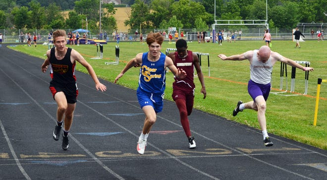 Clear Spring's Addison Eckardt crosses the finish line first in the boys 100-meter dash at the 1A West region championships Saturday at Smithsburg. Owen Brophy, right, of Smithsburg, places second.
