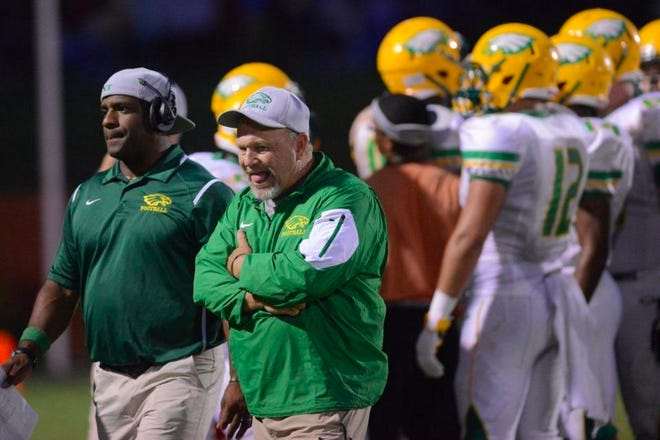 Eastern Alamance football coach and athletics director John Kirby, middle, is a recipient of the NCHSAA's Toby Webb Outstanding Coach Award.