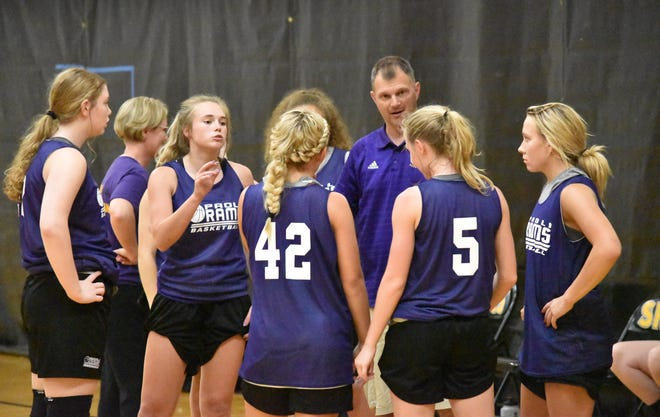 Paoli coach Donavan Crews speaks with his team during a break in its matchup with Tell City.