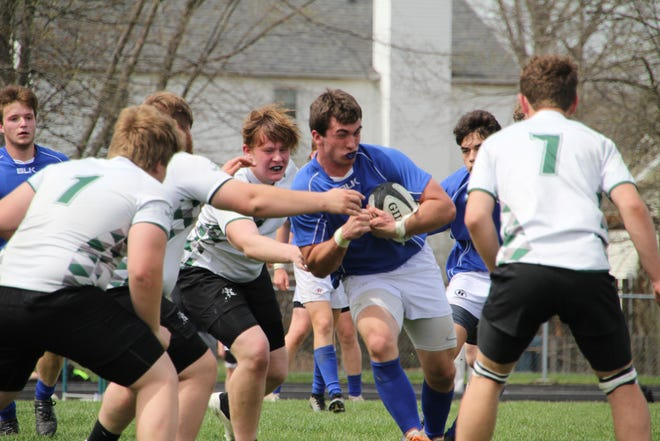 Tyler Yanka, a recent graduate of Orange, advances the ball during early season action for the Olentangy Blues rugby team. Competing in their first season, the Blues beat St. Charles 27-24 in the Large Club Division I championship game June 5 at Fortress Obetz.