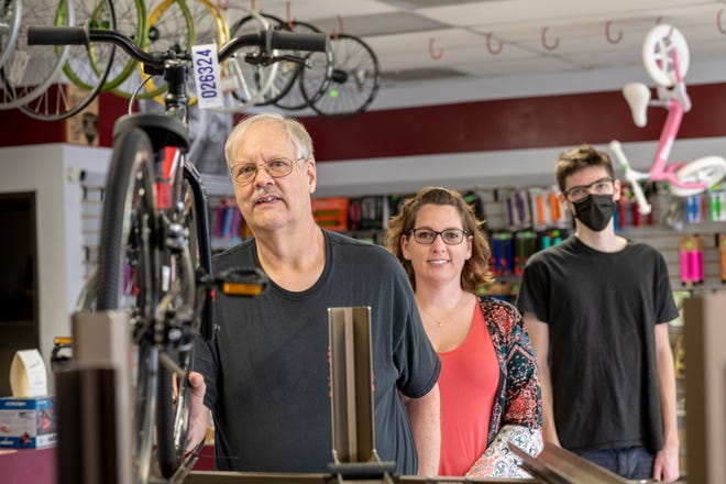 George Puleikis (left) with his daughter, Michelle Heaton, and grandson, Thomas Puleikis, at Hi-Desert Bikes. George Puleikis is preparing to retire and close the doors to the store after more than 30 years. The pandemic has made it too hard to get inventory to sell, he said.