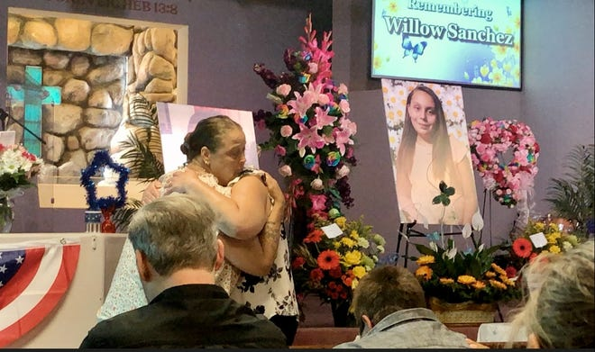 Willow Sanchez's mother, Lori (left), and aunt, Robbin, share an embrace during a Friday, June 11, 2021, celebration of life for Willow, one of three young girls killed in a hit-and-run crash in Lucerne Valley on Saturday, June 5, 2021.