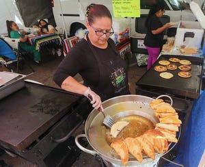 Maricruz del Villar fries empanadas for customers at the Mi Familia Swap Meet at the Perry Avenue Mall in Bremerton on Saturday, June 12, 2021.