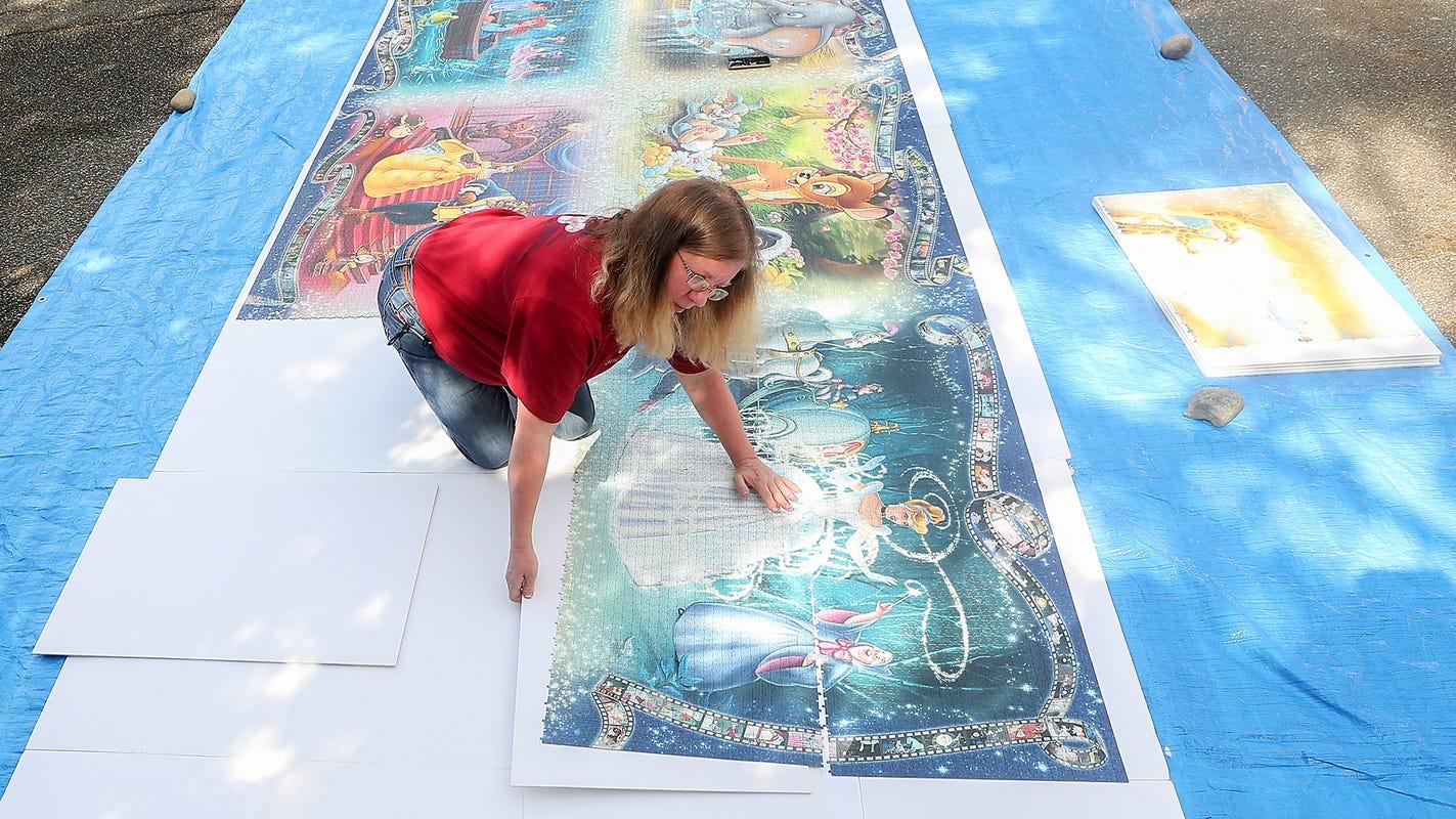 40,320 pieces of Disney: Bainbridge Island woman assembles a driveway-sized jigsaw puzzle