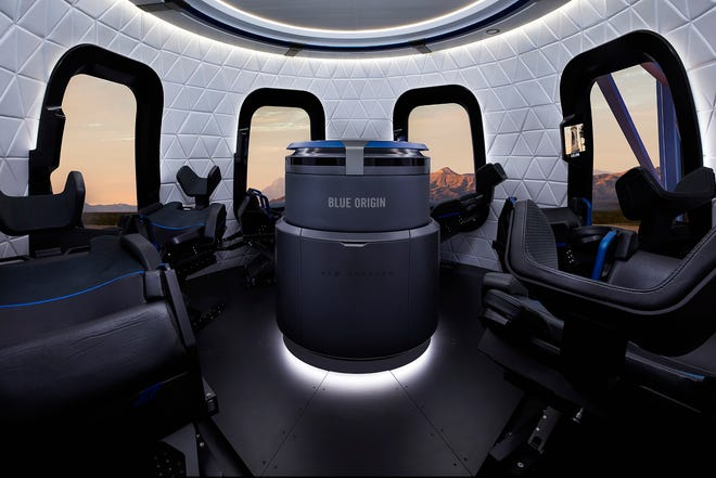A promotional image of New Shepard's interior. At center is the launch escape system used in the event of an emergency.