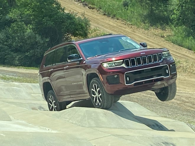 """The 2021 Jeep Grand Cherokee L negotiates """"camel humps"""" with 14-inch dips and rises at the Stellantis proving ground in Chelsea, Michigan."""