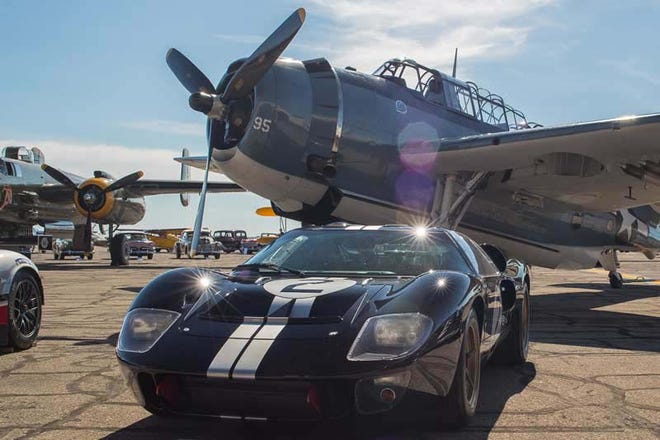 """Arranged on the ramp of the Yankee Air Museum, the exhibitincludes the event's """"poster car"""" Darrin Packard — a well as rare planes like the single-seat Douglas AD-1 Skyraider and a Grumman C-1 Trader cargo plane."""
