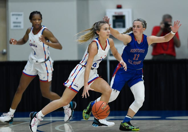 Indiana's Chloe McKnight (Bedford-North Lawrence) dribbles around Kentucky's Alexa Smiddy (Somerset Southwestern) during the Indiana Kentucky All-Star girls game at the Owensboro Sportscenter in Owensboro, Ky., Friday, June 11, 2021. The Indiana All-Stars defeated the Kentucky All-Stars 69-58.
