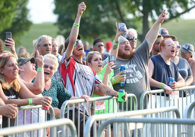 Concert attendees sing along with Boogie and the Yo Yos Friday, June 11, 2021 at Walleye Weekend in Lakeside Park in Fond du Lac, Wis.