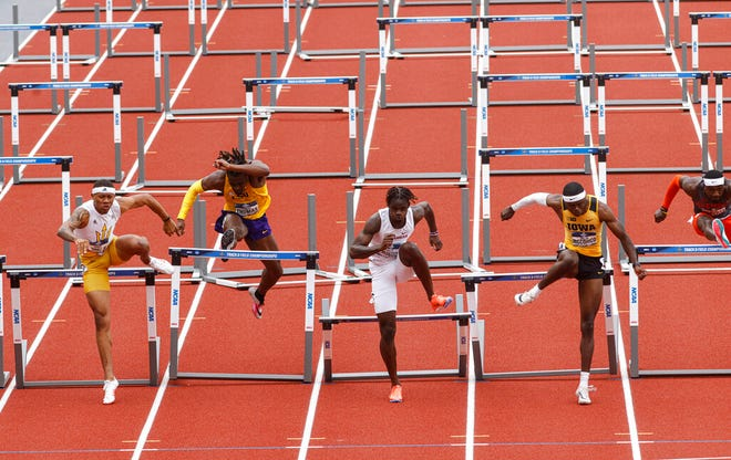 Jaylan McConico, right, competes in the men's 110 hurdles final Friday in Eugene, Oregon. He took second and Hawkeye teammate Jamal Britt (not pictured, in lane 8) was fourth.