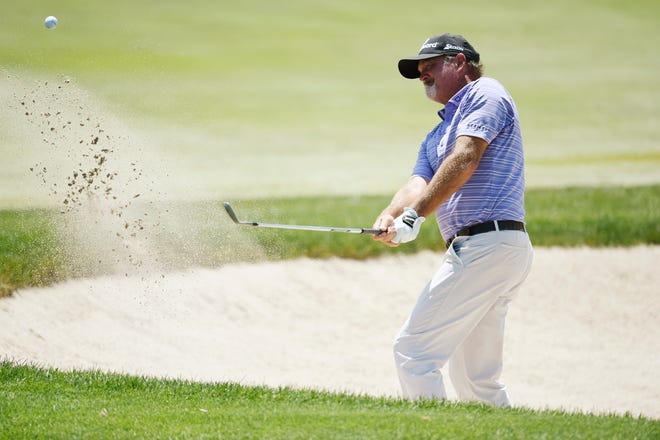 Jerry Kelly hits from a green-side sand trap on the fifth hole during the second round of the American Family Insurance Championship at University Ridge Golf Course in Madison.