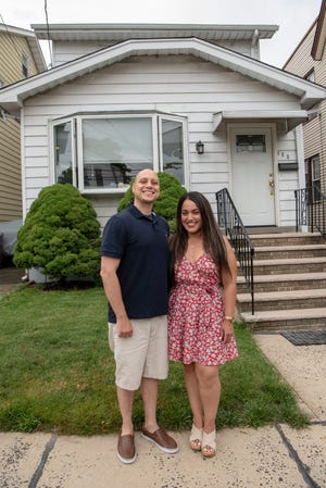 Antonio Aluotto and Prscilla Gabela-Aluotto pose for a photo by their North Arlington home on Friday June 11, 2021.