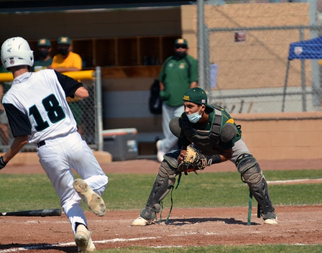 Mayfield catcher Anthony Carrillo waits for the ball at home plate for the force out as Oñate's Matt Hall tries to beat the throw.