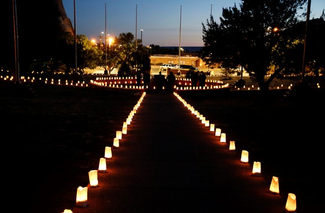 Luminarias light the Veterans Memorial Park in Window Rock, Ariz., on March 17, 2021, during an event to remember members of the Navajo Nation who died of COVID-19.