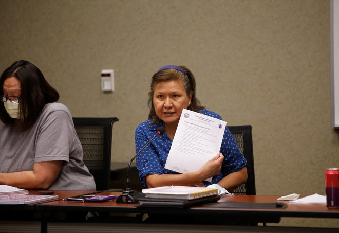 Shiprock Chapter President Nevina Kinlahcheeny shows the project list that chapter officials want funded by the amount the Navajo Nation received under the American Rescue Plan Act during a discussion with tribal officials on June 10 in Shiprock.