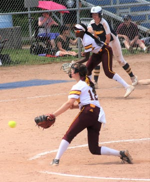 Farmington Hills Mercy freshman Asia Barbato delivers a pitch during the Marlins' June 12 victory over Clarkston.