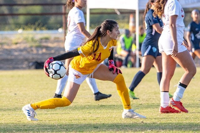 Kayla Ceballos, a goalkeeper for Desert Futbol Club gets the offense started in a recent game. The new women's soccer team in the desert plays its first home game Sunday.