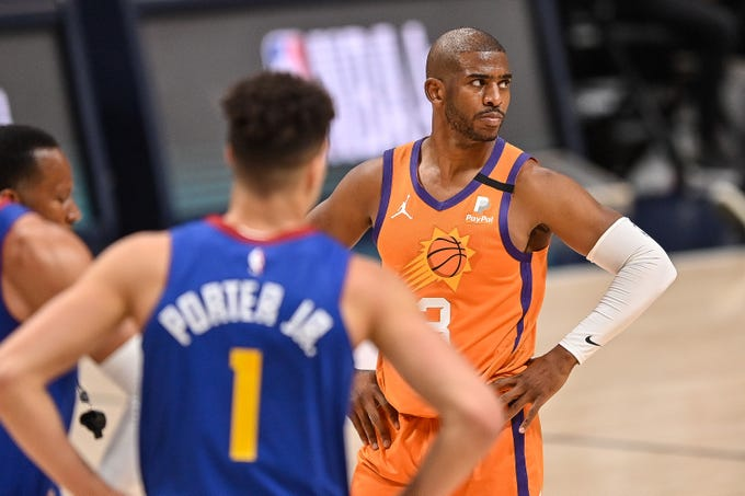 Chris Paul #3 of the Phoenix Suns looks on in the first half of Game Three of the Western Conference second-round playoff series at Ball Arena on June 11, 2021 in Denver, Colorado. NOTE TO USER: User expressly acknowledges and agrees that, by downloading and or using this photograph, User is consenting to the terms and conditions of the Getty Images License Agreement. (Photo by Dustin Bradford/Getty Images)
