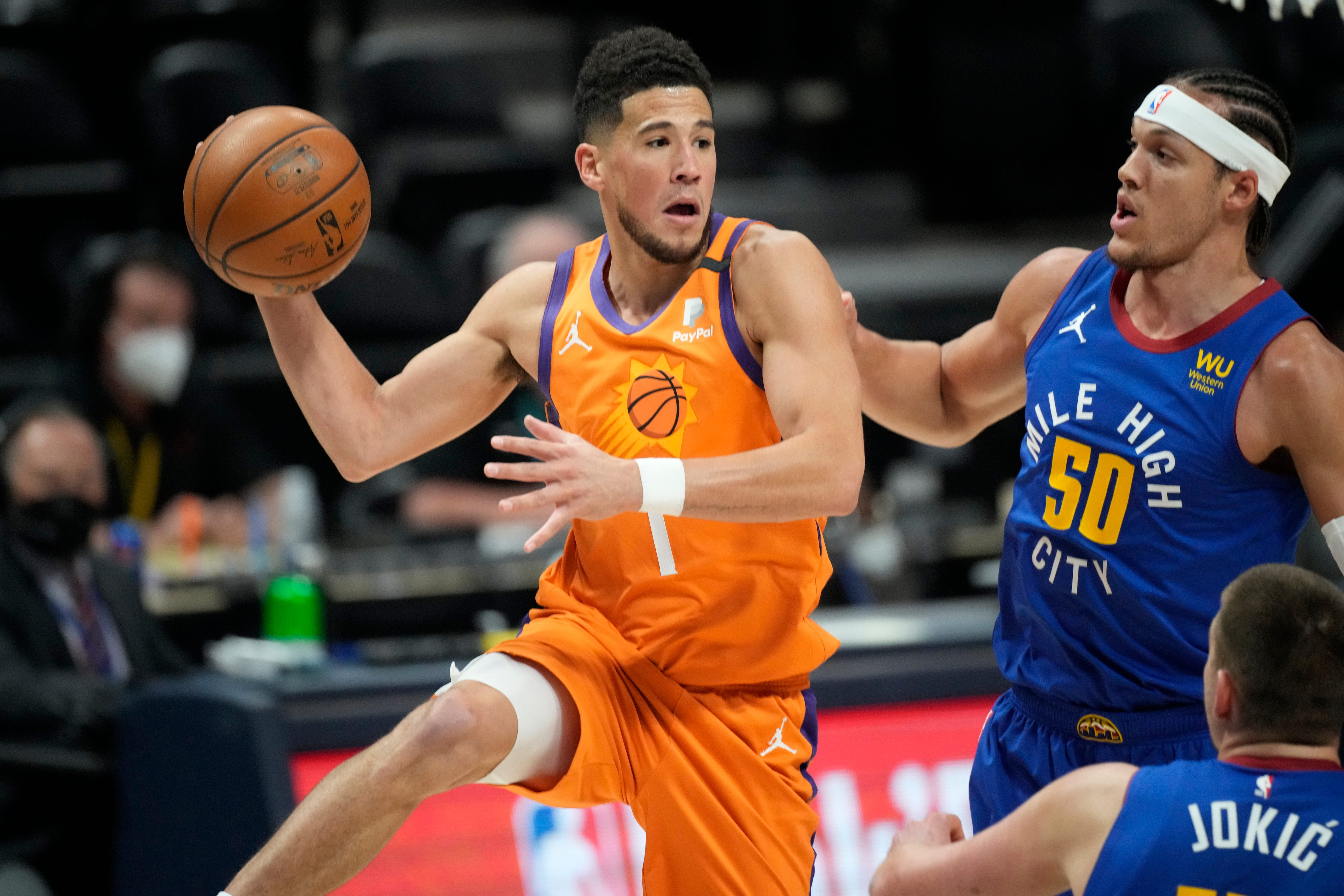'Suns in 4' fight fan to receive tickets, autographed jersey from Suns' Devin Booker