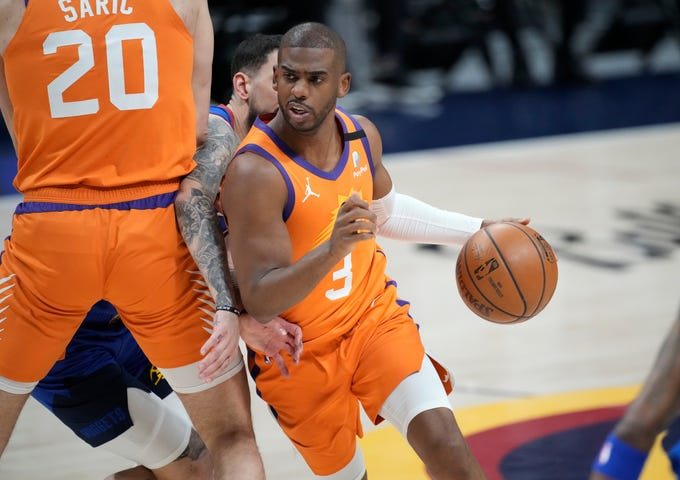 Phoenix Suns guard Chris Paul drives as Denver Nuggets guard Facundo Campazzo is slowed by screen by Suns forward Dario Saric during the first half of Game 3 of an NBA second-round playoff series Friday, June 11, 2021, in Denver. (AP Photo/David Zalubowski)