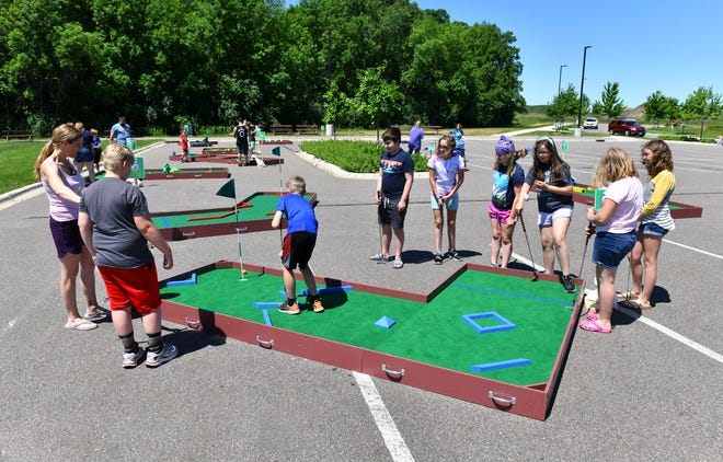 Miniature golf attracts participants during Sartell Summerfest events Saturday, June 12,  2021, at the Sartell Community Center.
