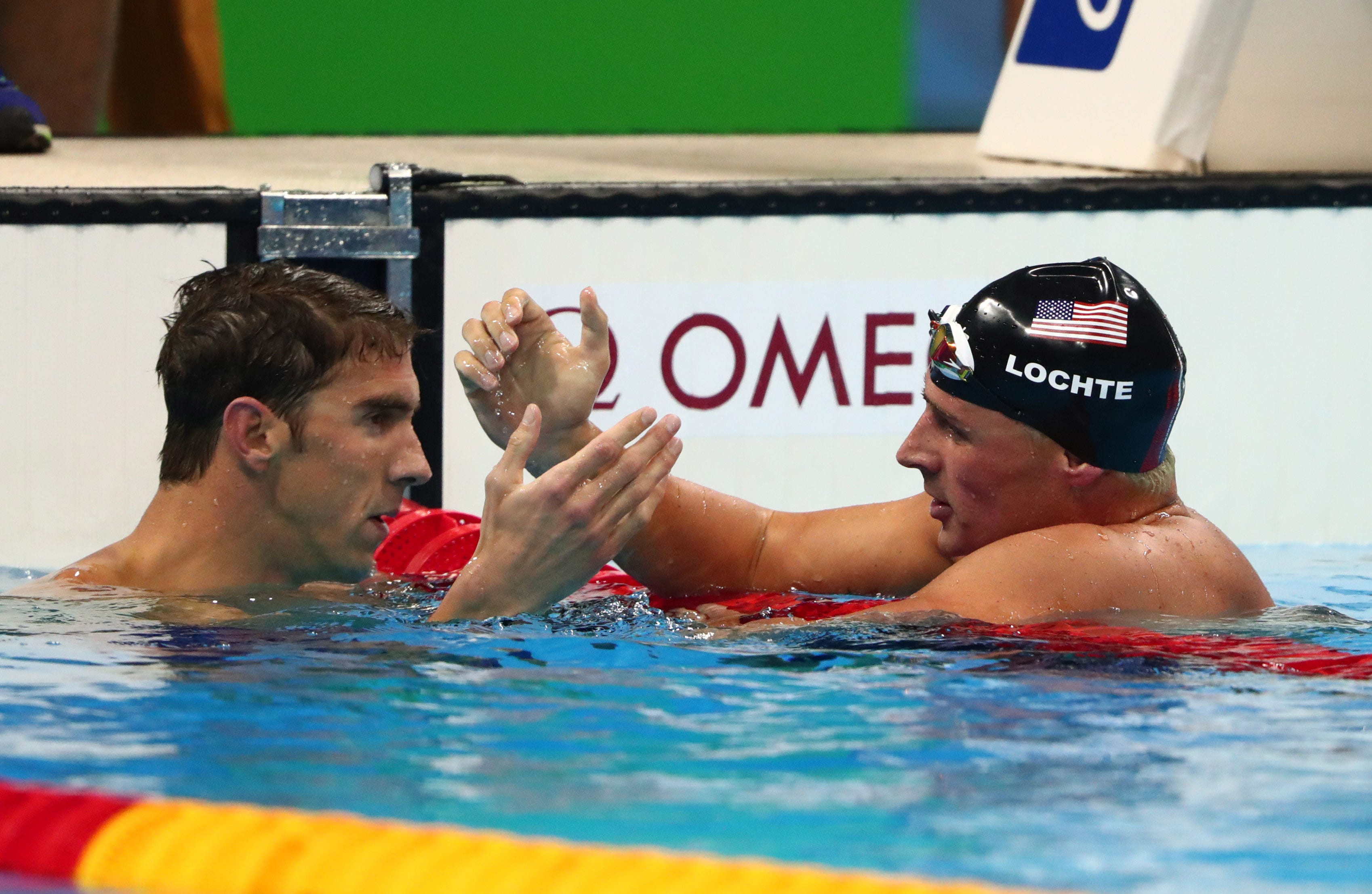 Frustrated with his training, Ryan Lochte got some help from Michael Phelps, a longtime rival in the pool